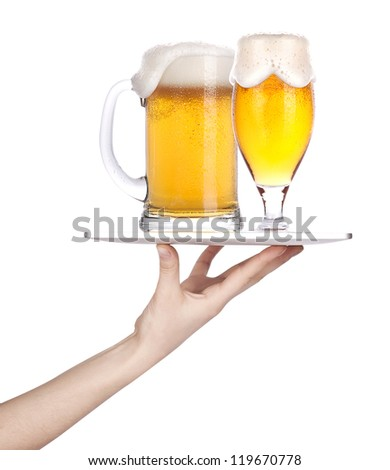 Waitresses hand holding a silver serving tray with a glass of beer. isolated