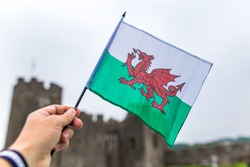 Waiving Welsh flag with red dragon in Pemborke castle, Wales