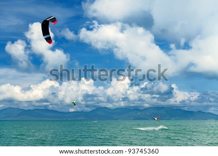 Wakeboarder jumping from water in open sea. Koh Samui, Thailand