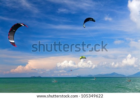 Wakeboarders jumping from water in open sea. Koh Samui, Thailand