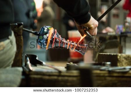 Waking glass sculptures in Murano - Shutterstock ID 1007252353
