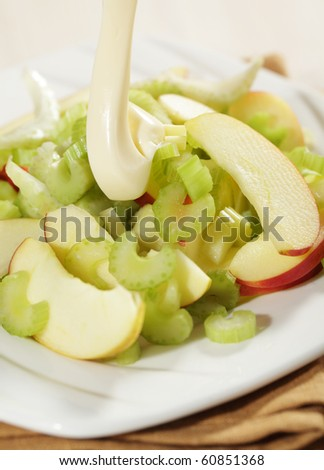 Waldorf salad with pouring mayonnaise