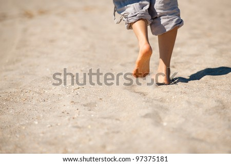 Walk barefoot on hot sand at the ocean