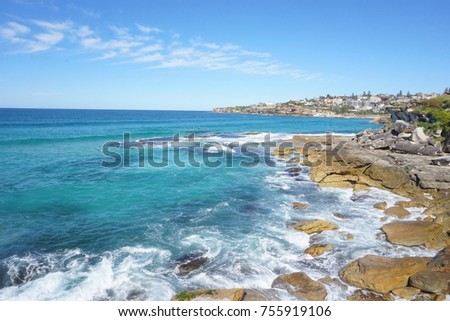 Walk between Bondi Beach and Cooge Beach in Sydney, ins a sunny day with good waves to surf #755919106