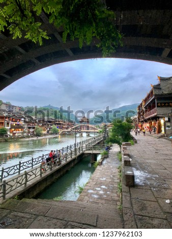 Walk bridge in  Fenghuang Ancient Town  (phoenix county) in Hunan, China. It's beautiful culture village town. The ancient town of Fenghuang was added to the UNESCO World Heritage Tentative List.