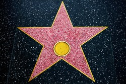 Walk of fame empty star on sidewalk background, hollywood concept style. Symbol of achievement, honor, famous entertainment and celebrity tribute.