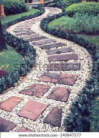 walk way in the garden (vintage tone) - stock photo