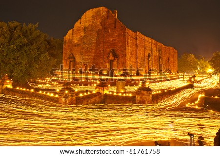 walk with lighted candles in hand around temple (Asalha puja day ) at Wat Maheyong Ayutthaya province Thailand