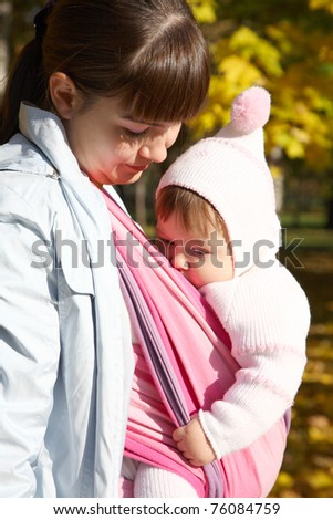 Walk with the child in a baby sling. Breastfeeding