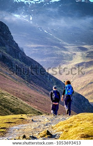 Walkers on mountain path, Lake District,