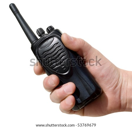 walkie-talkie in a man's hand on a white background
