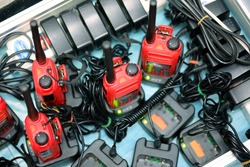 Walkie Talkie radio transmitters or portable communication device is charging on the floor.