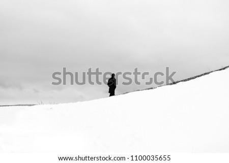 Walking alone in snow, Cappadochia, Turkey Stok fotoğraf ©