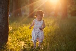 Walking baby in sunset lights
