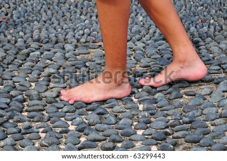 Walking Bare-Footed On Textured Stone Surface