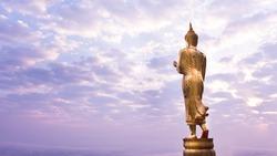 Walking Buddha statue at northern of thailand