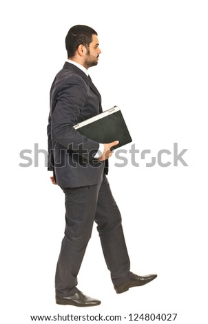 Walking business man holding laptop isolated on white background