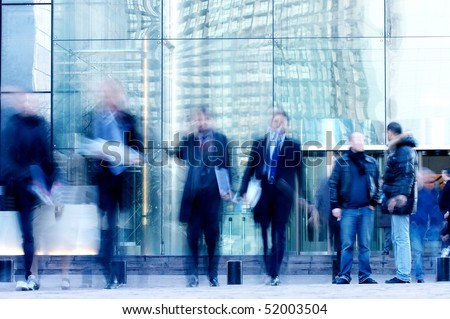 walking business people rushing on the street in motion blur - stock photo