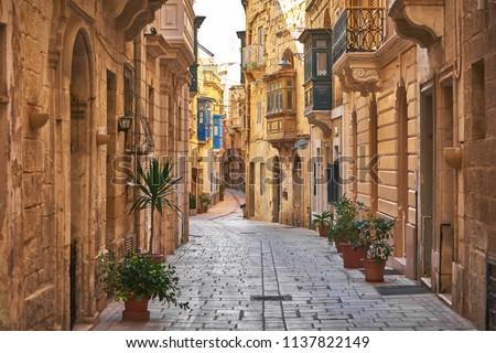 Walking cobblestone street in Birgu city, Malta Stock fotó ©