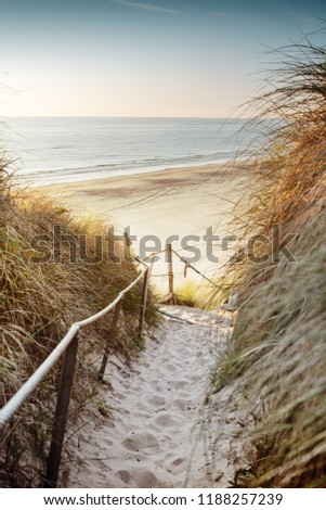 Walking down to the beach with sea overview at the evening enjoying sunset light. Best place to spent after a summer day. Løkken in North Jutland in Denmark, Skagerrak, North Sea