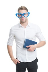 Walking encyclopedia. Funny man hold encyclopedia isolated on white. Reading encyclopedia book in fancy glasses. Encyclopedia facts and information. Education and knowledge. Reference book. Library.
