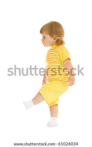 Walking girl in yellow shirt and pants