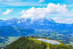 walking hiking clouds sky green alps tirol wilder kaiser kitzbuhel streif hahnenkamm summer sunny day grass neowise mountain rocky rock hallstatt austria vacation