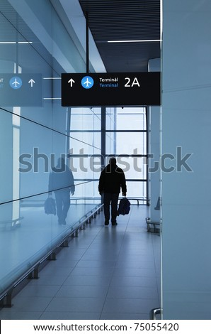 Walking man in the airport