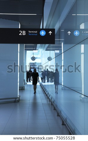 Walking men and woman in the airport