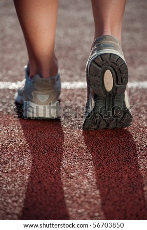 Walking on a running track. Close up of running sneakers