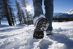 walking on the snow in the park