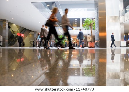 Walking people in modern business center. - stock photo
