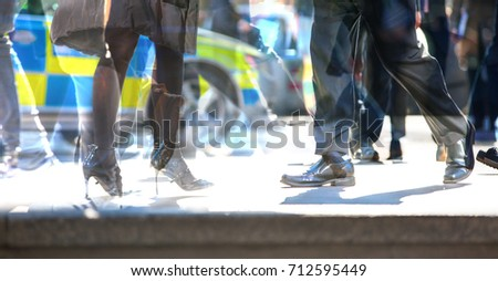 Walking people in the City of London. Multiple exposure image, modern life concept. - Shutterstock ID 712595449