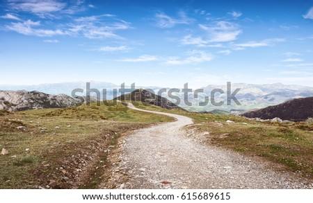 Shutterstock Walking route in Cantabrian Mountains, Picos de Europa National Park,  Asturias, Spain.