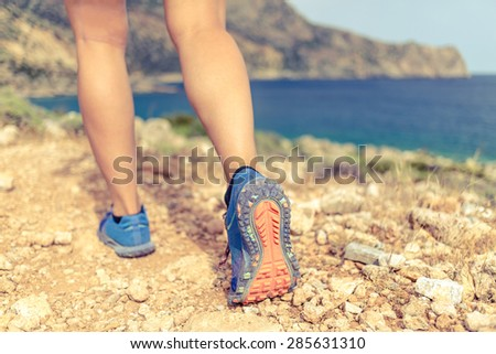 Walking running hiking or exercising, sports shoe and legs on rocky hiking trail in mountains, motivation inspiration concept outdoors, achievement fitness adventure and exercising in wild nature