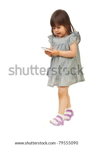 Walking smiling toddler girl searching on phone mobile isolated on white background