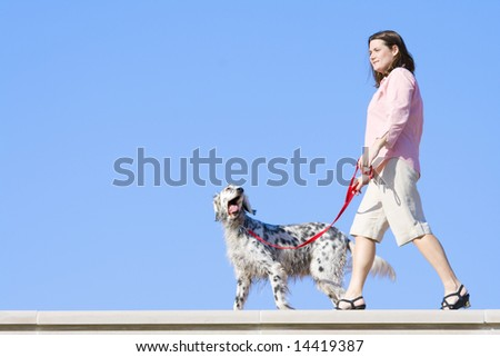 Walking the dog - stock photo
