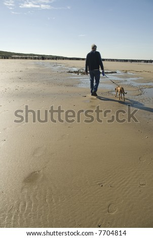 walking the dog at the beach