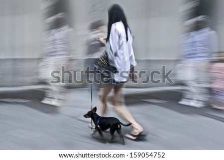 walking the dog on the street in motion blur