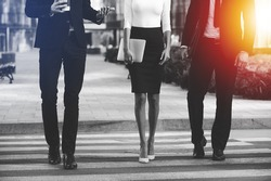 Walking to success together. Cropped image of three business people crossing the street