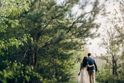 Walking wedding couple in the forest