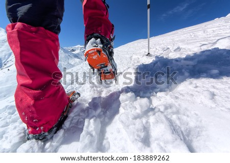 Walking with crampons  #183889262
