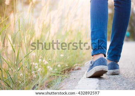 Walking women jeans and sneaker shoes #432892597