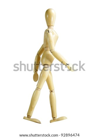 Walking wood puppet isolated over white background