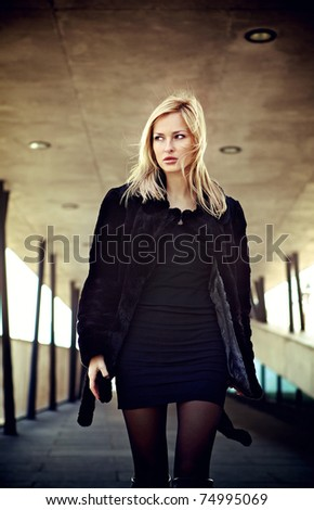 Walking young blonde woman