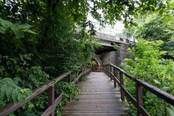 Walkway and Tunnel by the Ruins of the Old Dam at Dellwood Park in Lockport Illinois during the Summer