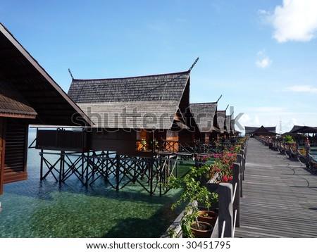 Walkway at tropical resort of Kapalai on Malaysian Borneo - stock photo