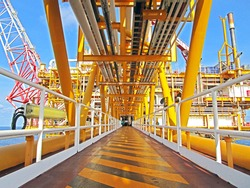 walkway between oil and gas processing platform offshore and flare tip