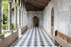walkway path with checkered pattern marble tiles floor in old cement gothic church