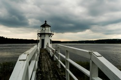 walkway to the lighthouse, with an approaching storm (tripod used, f16)
